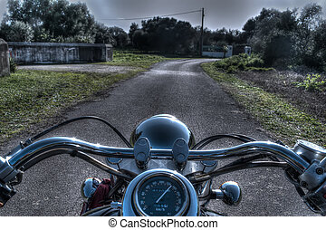 classic motorcycle on a country road in hdr tone mapping