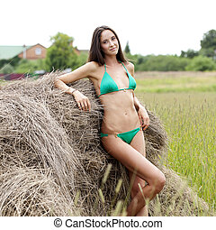 Beautiful model in a green bikini in the hayloft - Young...