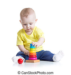 baby playing with toy, isolated on white background