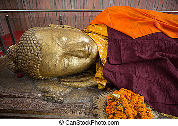 Reclining Buddha gold statue at the Mahaparinirvana Temple...