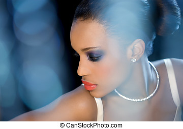 Bridal Beauty - Beautiful bride with dark skin sitting...