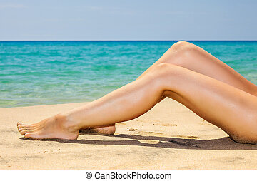 Woman's legs on the beach - Woman's beautiful legs on the...