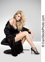 Fashion In Studio - Fashion model wearing black silk robe.