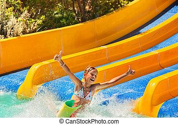 Child in bikini sliding water park. - Happy child girl in...