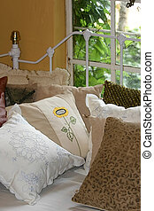 Colonial interior design, iron bed, embroider pillows