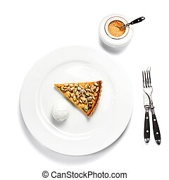Slice of fresh Pumpkin Pie with whipped cream and pumpkin seeds