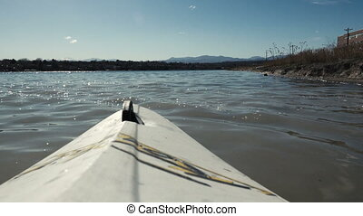 Lake Kayaking POV Kayak View - A view of a lake and...