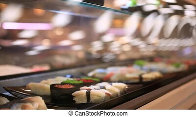 Variety of sushi on shelves in supermarket In Japan Close up...