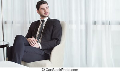 Thoughtful businessman in the hotel lobby - : Deep in...