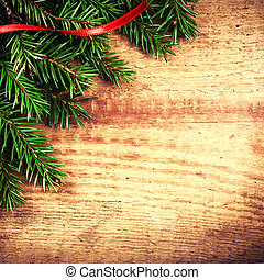 Christmas Background with Fir Tree Branch and red ribbon  on woo