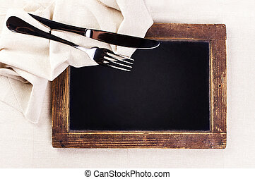 Vintage blackboard with wooden frame with linen towel and...