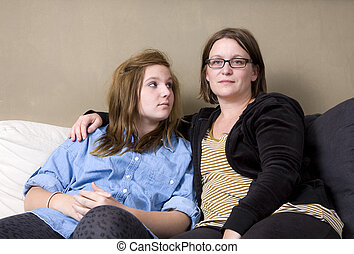 Mum, Whats wrong - Mother and daughter sitting in sofa...