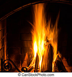 Home Fire burning in brick fireplace Seasonal and holiday...