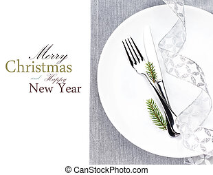 Christmas table place setting with christmas decorations in...