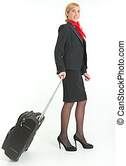 Air hostess on the go, carrying a suitcase