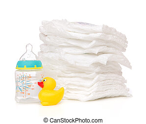 child stack of diapers baby feeding milk bottle with water -...