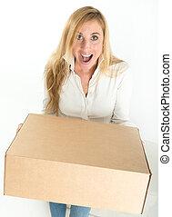 Surprise parcel - Happy woman holding a parcel