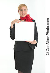 Hostess with blank board - Smiling hostess holding a blank...
