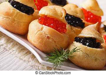 profiteroles with red and black caviar, horizontal - Fresh...