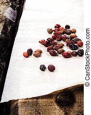 Dried briar or berry Rose hips on vintage wooden background....