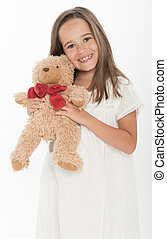 Little girl holding teddy bear - Cute little girl holding a...