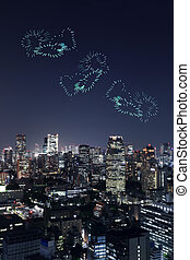 heart sparkle Fireworks celebrating over Tokyo cityscape at...