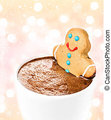Gingerbread cookie man take a bath in cup of Hot Chocolate,...