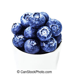Blueberries in a bowl  isolated on white background macro.
