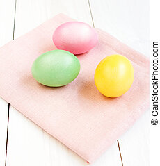 Colorful Easter eggs on wooden background, spring holidays.