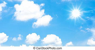 Cloudy blue sky with sun beam