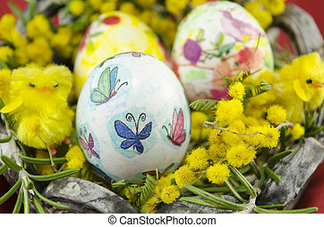 hand painted decoupage Easter egg in a basket