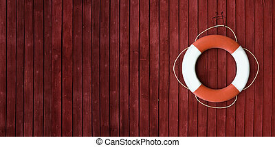 Red and white life buoy hanging on the side of a wooden ship