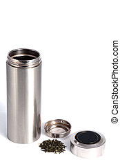 Chinese personal thermos with green tea leafs isolated on...