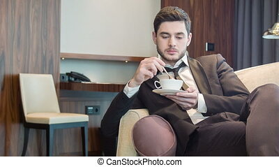 Young handsome man drinking coffee