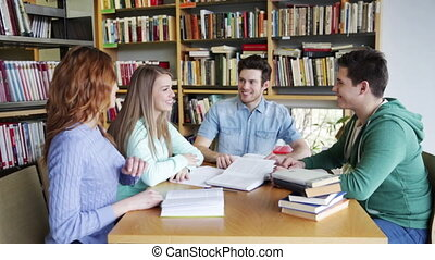 students with books in library