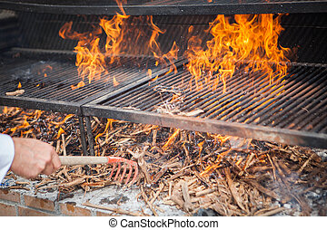 wood BBQ barbeque preparation - flamimg wood BBQ barbeque...