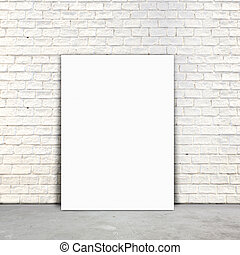 Blank Poster paper standing next to a white brick wall