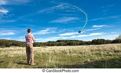 Man flying a kite  - A man flying a kite in the countryside