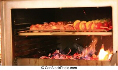 kebab meat roasts in the oven. HD. 1920x1080 - chef at work....