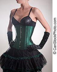Beautiful young woman in green corset