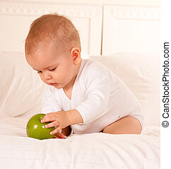 Cute baby and apple