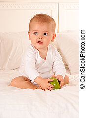 Baby and green apple