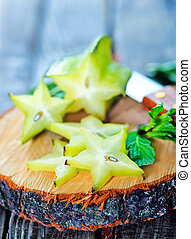 carambola on wooden board and on a table
