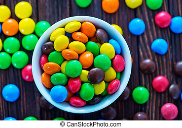 color candy in bowl and on a table