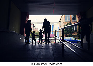 Young family with two little boys in a subway