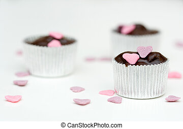 Homemade chocolate with pink and purple heart decorations