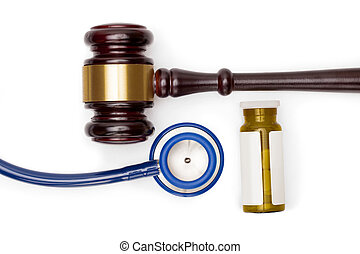 Judge gavel, pills bottle and stethoscope on white backround...