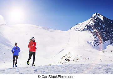 Couple jogging in winter nature - Young couple jogging...