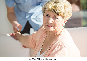 Woman having done an injection - Portrait of senior woman...