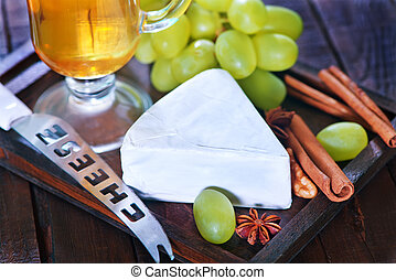 camembert and grape - camembert cheese with green grape on...